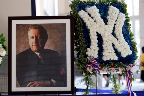 A picture honoring the late owner of the New York Yankees George Steinbrenner stands in the lobby of Yankee Stadium before their game against Tampa Bay Rays in New York