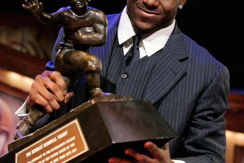 Reggie Bush Hoists the 2005 Heisman Trophy