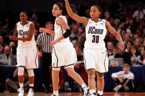 Huskies' Dixon raises her finger during their game against the Buckeyes in New York