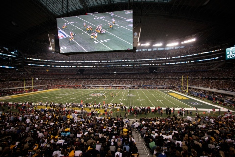 The Pittsburgh Steelers play the Green Bay Packers under a giant screen in Cowboys Stadium during the NFL's Super Bowl XLV football game in Arlington