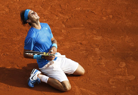Nadal of Spain reacts after defeating Federer of Switzerland during their men's final at the French Open tennis tournament at the Roland Garros stadium in Paris