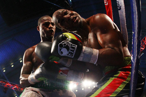Chad Dawson, left, lands a punch against Bernard Hopkins