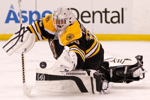 Boston Bruins goalie Tim Thomas makes a save against the Washington Capitals during the third period in Game 7 of their NHL Eastern Conference quarter-final hockey playoff series in Boston