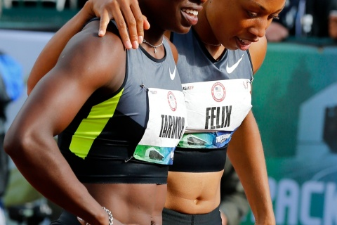 U.S. sprinter Allyson Felix puts her arm around Jeneba Tarmoh after the two runner tied for 3rd place in the women's 100m race at the U.S. Olympic athletics trials in Eugene