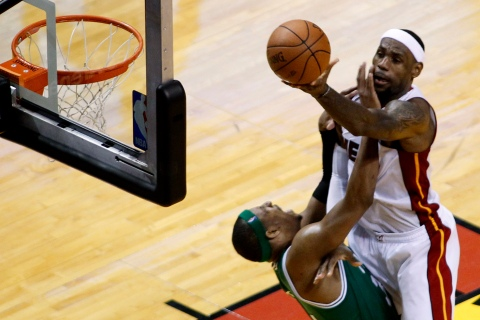 Miami Heat's James shoots over Boston Celtics' Pierce in the third quarter during Game 7 of their Eastern Conference Finals NBA basketball playoff series in Miami