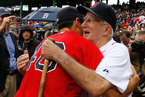 Jacoby Ellsbury embraces Boston Red Sox great Johnny Pesky during a ceremony where Pesky's No. 6 was retired prior to a game against the New York Yankees at Fenway Park September 28, 2008.