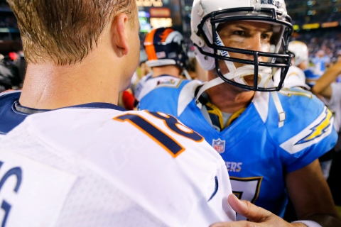 San Diego Chargers quarterback Rivers greets Denver Broncos quarterback Peyton Manning (L) after losing to Denver following their Monday Night NFL football game in San Diego