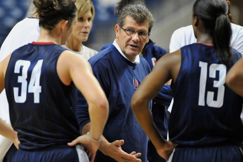 image: Connecticut coach Geno Auriemma speaks with Kelly Faris, left, as Brianna Banks listens during practice before the NCAA college basketball team's media day in Storrs, Conn., Oct. 16, 2012.