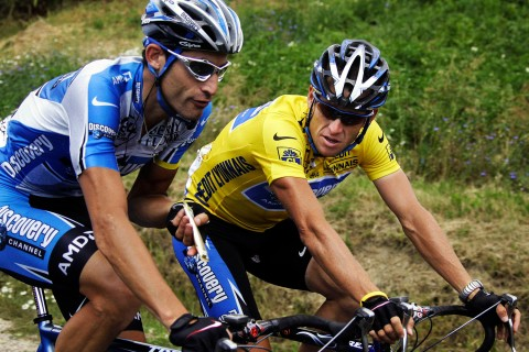 File photo of Discovery Channel team rider Lance Armstrong of the U.S. cycling alongside team mate George Hincapie during 92nd Tour de France