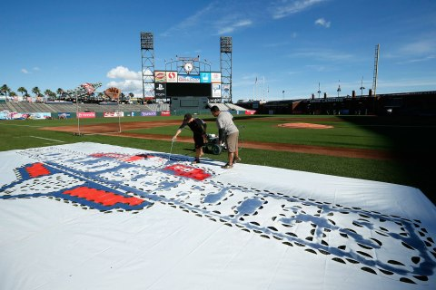 image: Grounds crew paint the World Series logo onto the field at ATT Park in San Francisco, Oct. 23, 2012.