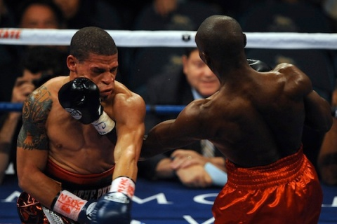 Cornelius Lock of the US (R) bouts Orlando Cruz