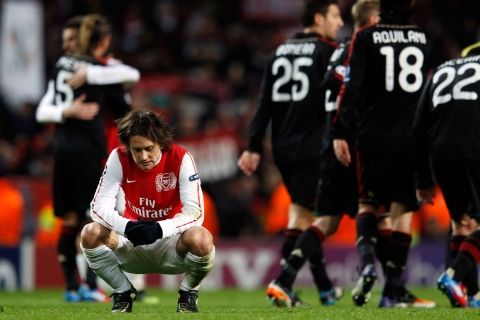 Tomas Rosicky of Arsenal reacts after the team was defeated by AC Milan in their Champions League last 16 second leg soccer match in London