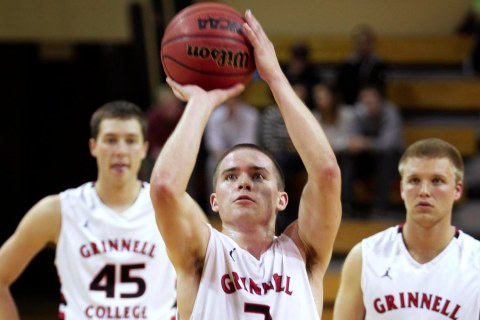 image: Grinnell's record-breaker Jack Taylor shoots a free throw during the game in which he scored 138 points.