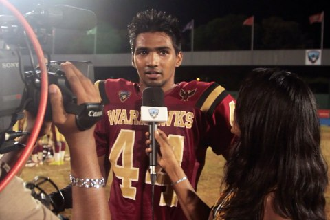 image: Roshan Lobo of the Bangalore Warhawks is interviewed by a television reporter.