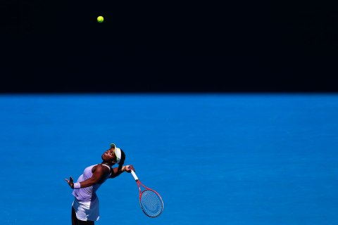 Sloane Stephens of the U.S. serves to compatriot Serena Williams during their women's singles quarter-final match at the Australian Open tennis tournament in Melbourne