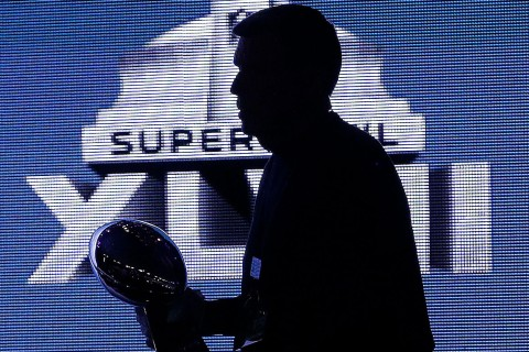 Ben Nix, from NFL security, carries the Vince Lombardi Trophy in preparation for a news conference between San Francisco 49ers head coach Jim Harbaugh and Baltimore Ravens head coach John Harbaugh for the NFL Super Bowl XLVII football game on Feb. 1, 2013, in New Orleans.