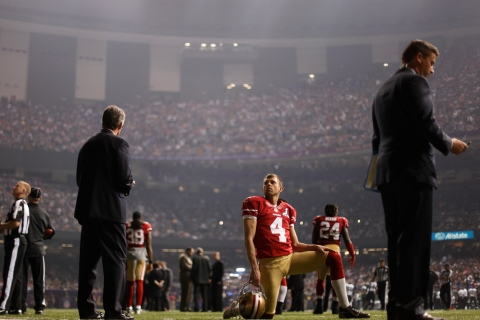 San Francisco 49ers punter Andy Lee looks on during a power outage in the second half of the NFL Super Bowl XLVII football game against the Baltimore Ravens in New Orleans, Feb. 3, 2013.