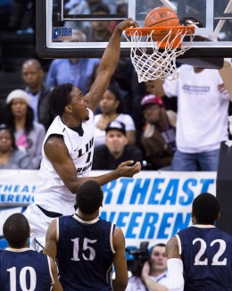 LIU Brooklyn's Jamal Olasewere dunks the ball during the second half of their NCAA Northeast Conference college basketball championship game against Mount St. Mary's.