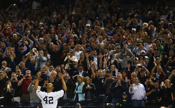 Mariano Rivera waves to the crowd after leaving the game against the Tampa Bay Rays in the ninth inning at Yankee Stadium in the Bronx borough of New York City, Sept. 26, 2013.