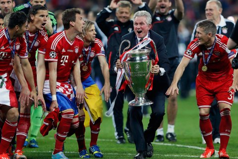 Bayern Munich coach Jupp Heynckes celebrates with the trophy and his players after defeating Borussia Dortmund in their Champions League Final soccer match at Wembley Stadium in London