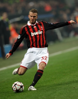 AC Milan's English midfielder David Beckham takes a free kick against Manchester United during their UEFA Champions League round of 16 match at San Siro stadium in Milan, on Feb. 16, 2010.