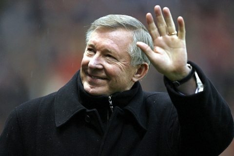 Manchester United manager Alex Ferguson waves to the crowd prior to a match against Reading in Manchester, Dec. 30, 2006.