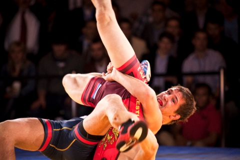 From right: American Logan Stieber turns Russia's Opan Sat during at the Rumble on the Rails wrestling match in Grand Central Terminal in New York City, on May 15, 2013.