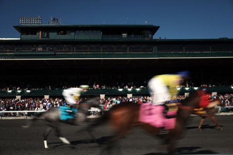 Horses race at Keeneland in Lexington, Ky.