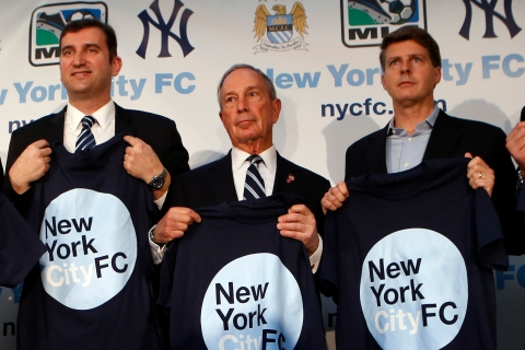 Principles hold New York City FC T-shirts at news conference in New York