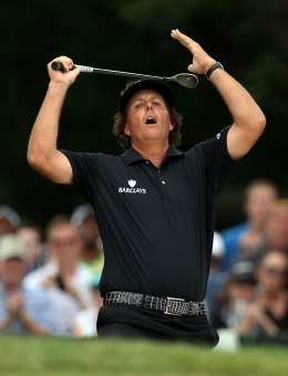 Phil Mickelson reacts to his bunker shot that narrowly misses the 2nd hole during the final round of the U.S. Open Championship golf tournament at Merion Golf Club's East Course on June 16, 2013.