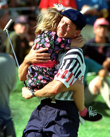 Payne Stewart huggs his daughter Chelsea after winning the US Open golf championship in Chaska, Minn., June 17, 1991.