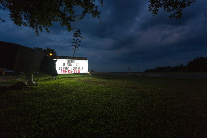 """A sign at a local shop referencing the phenomenon of """"Johnny Football"""" is seen in College Station, Texas, Sept. 14, 2013."""