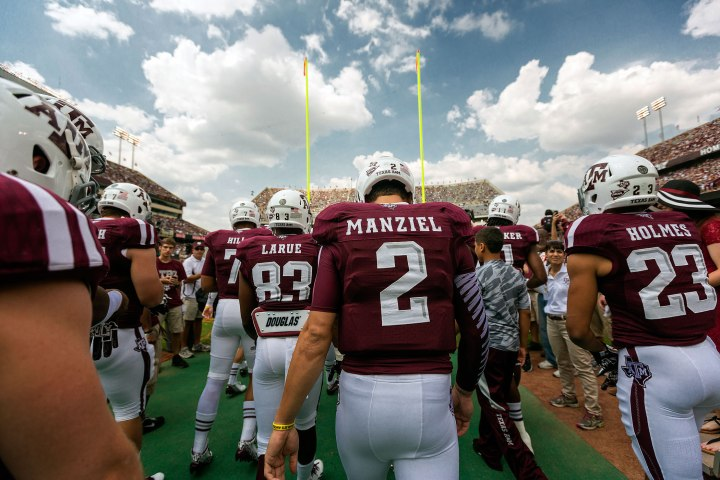 Texas A&M quarterback Johnny Manziel walks with his teammates onto the field for warm ups prior to an NCAA football game between the Texas A&M Aggies and the University of Alabama Crimson Tide.