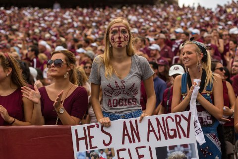 A Texas A&M football fan shows off her colors.