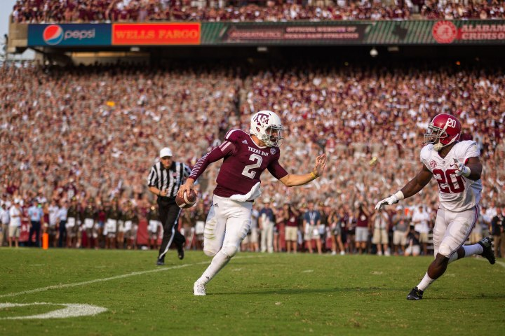 Texas A&M quarterback Johnny Manziel scrambles away from a defender.