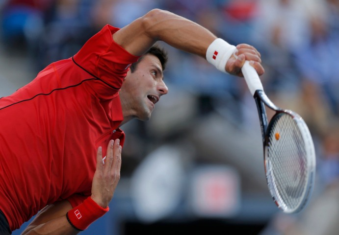 Djokovic of Serbia serves to Nadal of Spain during their men's final match at the U.S. Open tennis championships in New York