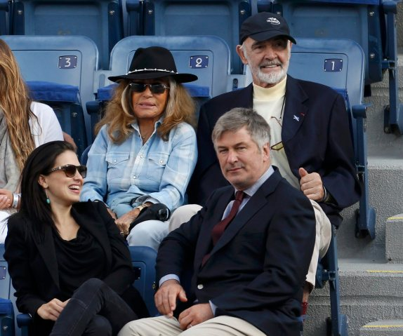 Actors Baldwin and Connery watch Nadal of Spain face Djokovic of Serbia in the men's final match at the U.S. Open tennis championships in New York