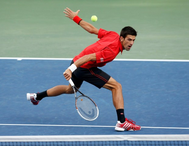 Djokovic of Serbia hits a return to Nadal of Spain during their men's final match at the U.S. Open tennis championships in New York