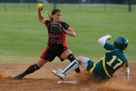 Australia's Leigh Godfrey (17) is forced out at second base by Canada's Natalie Wideman in the fifth inning of the World Cup of Softball in Oklahoma City, July 14, 2013.
