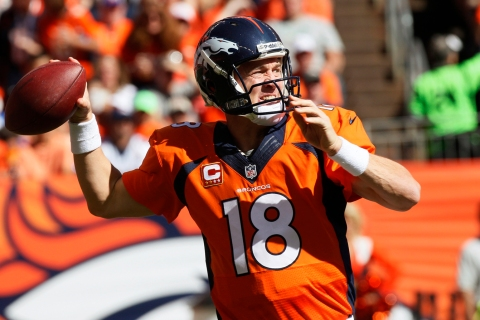 Denver Broncos quarterback Peyton Manning throws against the Philadelphia Eagles in their NFL game in Denver