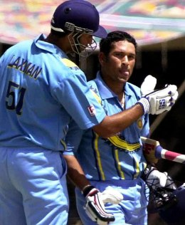 Tendulkar is congratulated by a teammate after completing a century during a match between India and Australia at Nehru stadium in Indore March 31, 2001.
