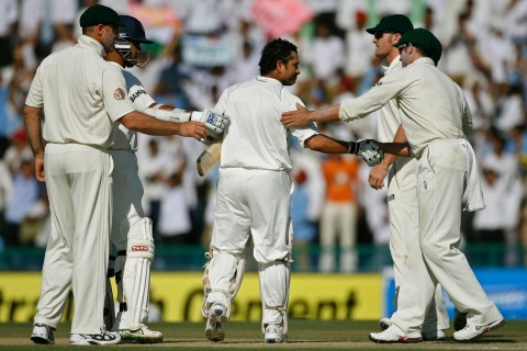 India's Tendulkar is congratulated by team mate Ganguly and Australian players during second test cricket match in Mohali