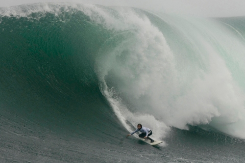 Brazil's Carlos Burle rides a wave during the 2008 Big Wave Africa surfing event held at Dungeons