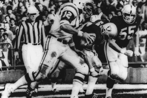 New York Jets' quarterback Joe Namath sweeps around the right side past Oakland defenders Ralph Oliver and Dan Conners to score from the one-yard line during the second quarter against the Oakland Raiders, Nov. 17, 1968 at the Oakland Coliseum in Calif.