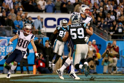 Rob Gronkowski #87 of the New England Patriots and Luke Kuechly #59 of the Carolina Panthers fight for the ball in the end zone on the last play of the game at Bank of America Stadium on Nov. 18, 2013 in Charlotte, N.C.