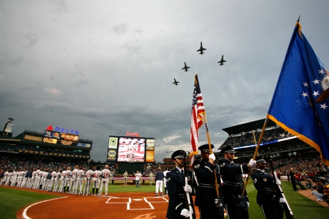 Jets from Vance Air Force Base perform a flyover above Turner Field during opening day festivities in Atlanta