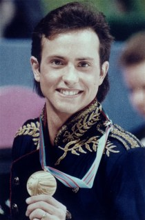 In this Feb. 20, 1988 file photo, figure skater Brian Boitano shows off his Olympic gold medal, in Calgary, Alberta.
