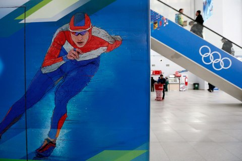 Visitors use an escalator in the Media Centre at the Olympic Park in Adler near Sochi