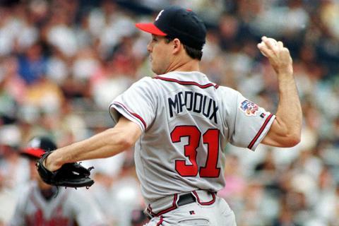 Atlanta Braves starting pitcher Greg Maddux throws