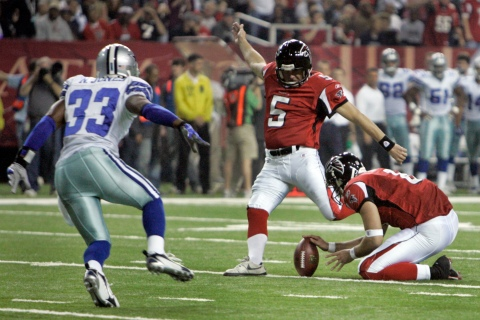 Atlanta Falcons' Matt Schaub holds the ball as Morten Andersen kicks an extra point against the Dallas Cowboys during the first half of an NFL football game, Dec. 16, 2006, in Atlanta.